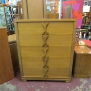 light mahogany chest of drawers with X motif drawer pulls – $495