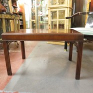 vintage mahogany coffee table with straight, fluted legs – $175