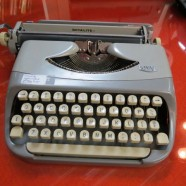 Vintage mid-century blue-gray Royalite typewriter and case – $145