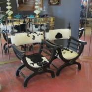 vintage mid-century ebonized X-chairs with cowhide