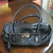 recent vintage authentic Prada black leather baguette purse – $850