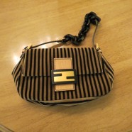 authentic vintage small tan and black striped Fendi purse – $250