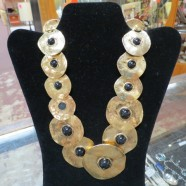 vintage gold disc necklace with round black stones – $132