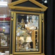 Vintage neoclassical black and gold wood mirror – $395
