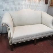 Vintage antique Georgian style camelback mahogany settee – $675